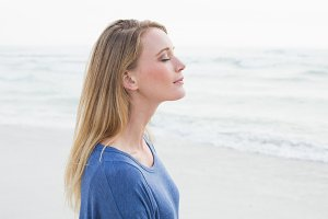 Peaceful woman with eyes closed at beach