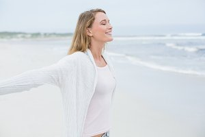 Casual young woman with eyes closed at beach
