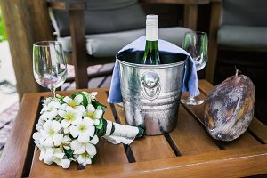 Bottle of champagne in bucket and glasses