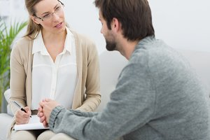 Young man in meeting with a psychologist