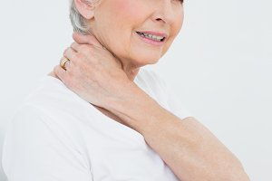Side view portrait of a senior woman suffering from neck pain