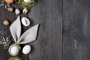 Easter wooden background with eggs