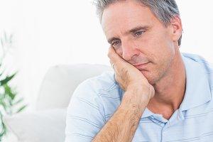 Depressed man thinking