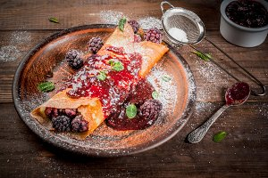 Crepes with berry and jam