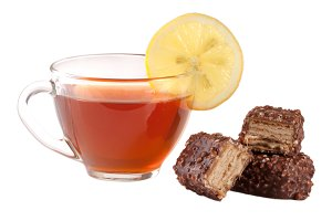 chocolate candy with a cup of tea isolated on white background