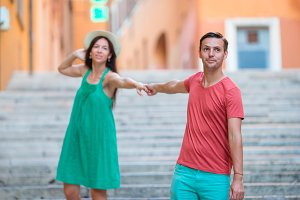 Romantic couple holding hands on Steps in Rome enjoy italian holidays.