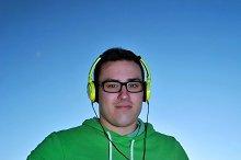 MUSIC MAN LISTENING THROUGH HEADPHON