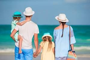 Happy beautiful family with kids on tropical beach