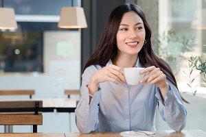 Beautiful woman drinks coffee