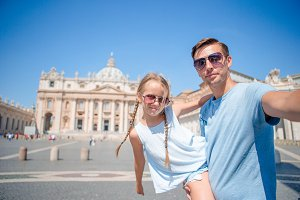 Happy family background St. Peter's Basilica church in Vatican city taking selfie