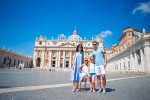 Happy family background St. Peter's Basilica church in Vatican city.