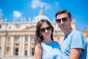 Happy couple at St. Peter's Basilica church in Vatican, Rome. The St. Peter's Basilica church is the main attractions