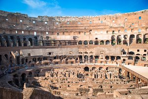 Colosseum or Coliseum indoor background blue sky in Rome, Italy