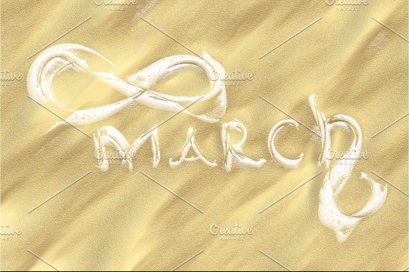 March 8 greeting card. Background for International Women's Day. Lettering made by ivory in the desert sand, creative concept in Objects