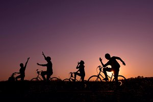 Happy 4 friends on bicycles