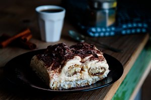 tiramisu dessert on rustic table