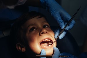 Dentists with a boy patient.
