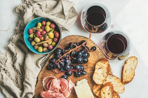 Variety of snacks and red wine