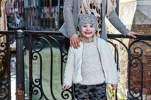mother and daughter tourists in Venice, Italy in winter