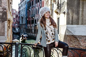 smiling woman in Venice, Italy in winter looking into distance
