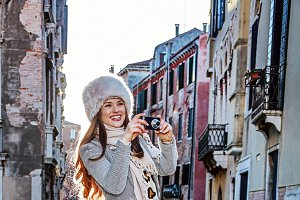 traveller woman in Venice taking photo with digital camera