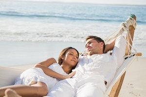Peaceful couple relaxing on hammock