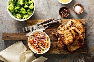 Grilled pork chops with cole slaw salad