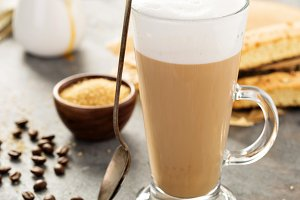 Hot coffee latte with biscotti cookies