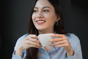 beautiful woman drinks coffee