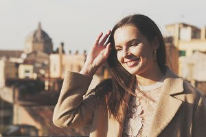 Happy young woman in Rome