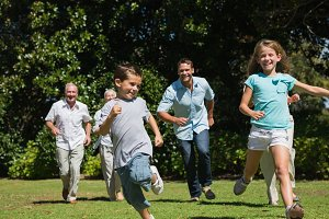 Happy multi generation family racing towards camera