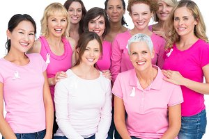 Voluntary pretty women posing and wearing pink for breast cancer