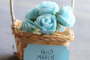 Hello March concept. Rustic still life, roses and tag