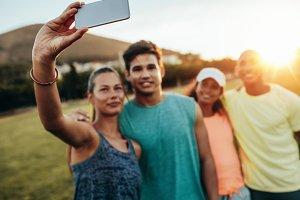Woman taking selfie with friends