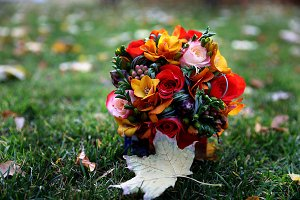 Autumn wedding bouquet lay on the grass