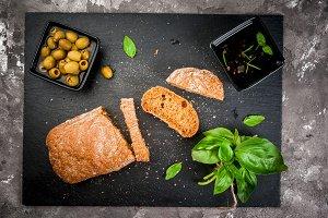 Rye ciabatta, oil, olives & herbs