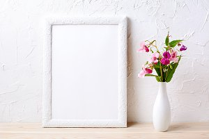 White frame mockup with pink flowers