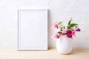 White frame mockup with pink plants