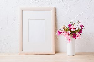 Wooden frame mockup with pink flower