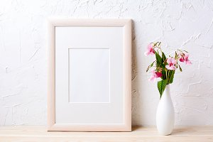 Wooden frame mockup with wildflowers