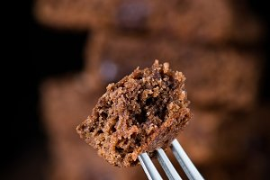 Piece of chocolate cake on a fork