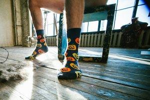 Men's feet in funny socks