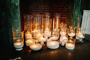Decorative candles in glass containers
