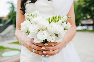 Bride holding bouquet white