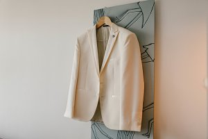 Men's white jacket on a hanger
