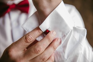 Groom button red cufflinks on shirt