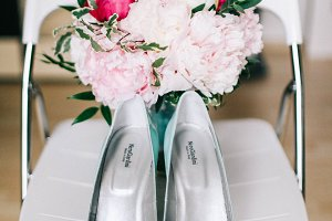Wedding bouquet of peonies with turquoise shoes
