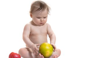Baby with red and green fruits