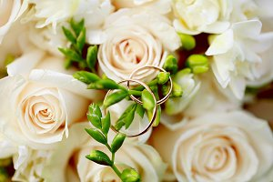 Wedding rings close-up on bouquet