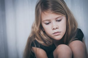 Portrait of sad little girl